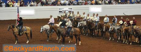 Ranch rodeo grand entry with the American flag.