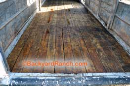 Horse trailer repair - linseed oil treatments will protect new floor boards.